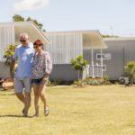 Couple outside Caravan Park Cabin